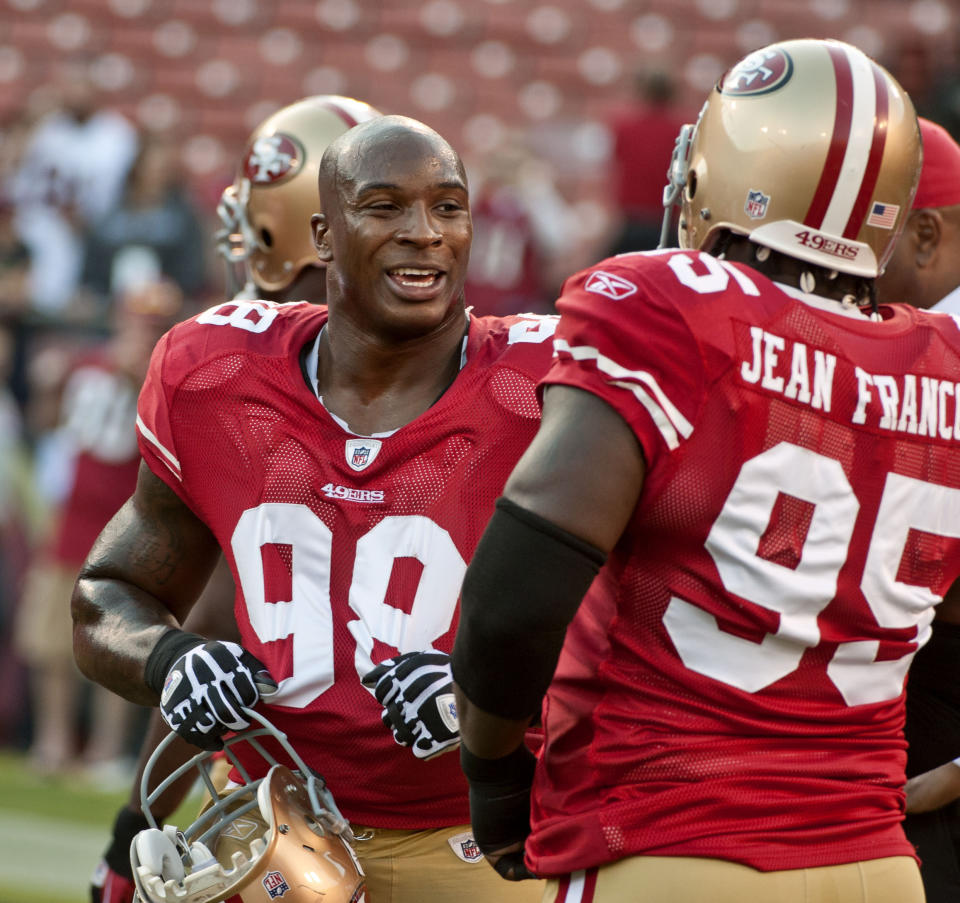 Pictured here, Parys Haralson #98 talks to defensive tackle Ricky Jean-Francois #95 during a 49ers pre-season game in 2010.