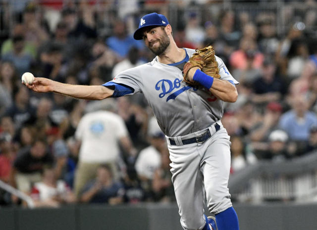 Los Angeles Dodgers shortstop Chris Taylor throws out Atlanta Braves' Ronald Acuna Jr. during the sixth inning of a baseball game Friday, July 27, 2018, in Atlanta. (AP Photo/John Amis)