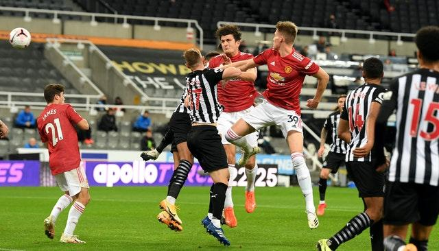 Harry Maguire, centre, equalised for Manchester United