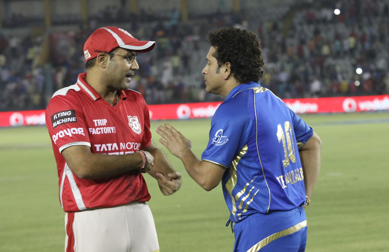 Virender Sehwag of the Kings X1 Punjab and Mumbai Indians icon Sachin Tendulkar after match 48 of the Pepsi Indian Premier League Season 2014 between the Kings XI Punjab and the Mumbai Indians held at the Punjab Cricket Association Stadium, Mohali, India on the 21st May  2014  Photo by Arjun Panwar / IPL / SPORTZPICS    Image use subject to terms and conditions which can be found here:  https://ec.yimg.com/ec?url=http%3a%2f%2fsportzpics.photoshelter.com%2fgallery%2fPepsi-IPL-Image-terms-and-conditions%2fG00004VW1IVJ.gB0%2fC0000TScjhBM6ikg&t=1506379637&sig=Ee60S8tAONIdXf8sAq1RUw--~D