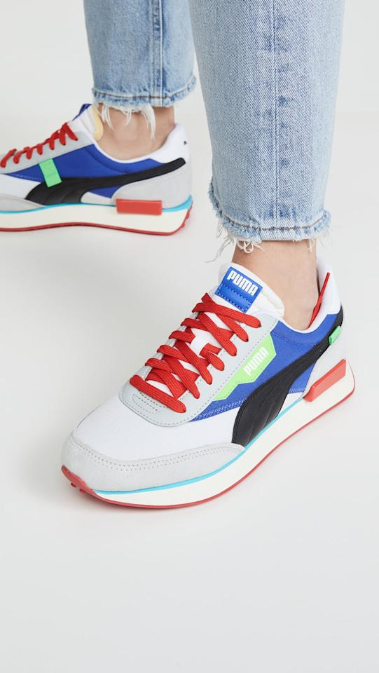 "<p>We love the old-school look of these <a href=""https://www.popsugar.com/buy/PUMA-Rider-Ride-Sneakers-537029?p_name=PUMA%20Rider%20Ride%20On%20Sneakers&retailer=shopbop.com&pid=537029&price=80&evar1=fab%3Aus&evar9=45820599&evar98=https%3A%2F%2Fwww.popsugar.com%2Ffashion%2Fphoto-gallery%2F45820599%2Fimage%2F47065809%2FPUMA-Rider-Ride-On-Sneakers&list1=shopping%2Cshoes%2Csneakers&prop13=mobile&pdata=1"" rel=""nofollow"" data-shoppable-link=""1"" target=""_blank"" class=""ga-track"" data-ga-category=""Related"" data-ga-label=""https://www.shopbop.com/rider-ride-sneakers-puma/vp/v=1/1588643780.htm?folderID=13439&amp;fm=other-shopbysize-viewall&amp;os=false&amp;colorId=18C96&amp;ref=SB_PLP_NB_49"" data-ga-action=""In-Line Links"">PUMA Rider Ride On Sneakers</a> ($80).</p>"