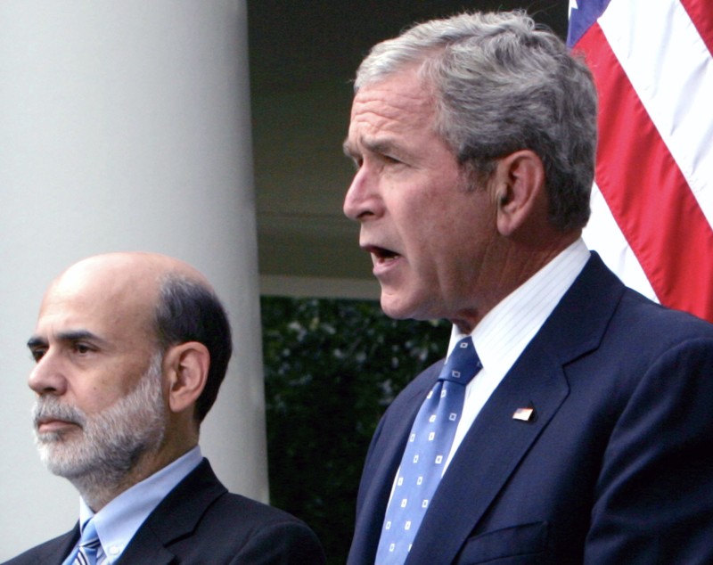 U.S. President George W. Bush and Ben S. Bernanke, chairman of the U.S. Federal Reserve, in the Rose Garden of the White House in Washington, D.C., U.S., on Friday, Sept. 19, 2008. (Photo: Dennis Brack/Bloomberg via Getty Images)