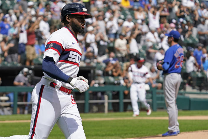 Chicago White Sox's Luis Robert rounds the bases after hitting a solo home run during the first inning of a baseball game against the Chicago Cubs in Chicago, Sunday, Aug. 29, 2021. (AP Photo/Nam Y. Huh)
