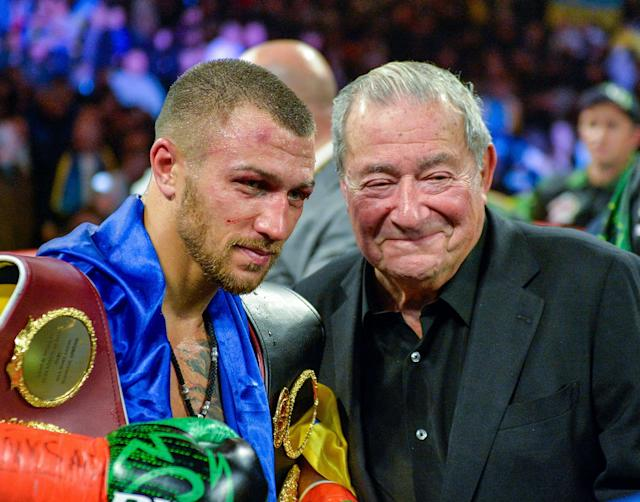 Vasiliy Lomachenko poses with promoter Bob Arum after defeating Jose Pedraza in the WBO title lightweight boxing match at Madison Square Garden, Saturday, Dec. 8, 2018, in New York. (AP Photo)