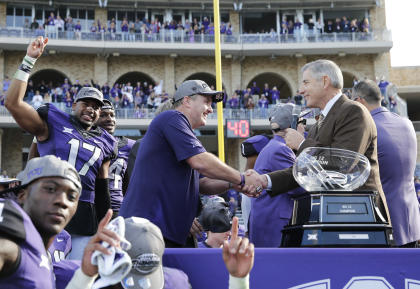 Big 12 commish Bob Bowlsby (R) hands the Big 12 trophy to TCU's Gary Patterson on Saturday. (USAT)
