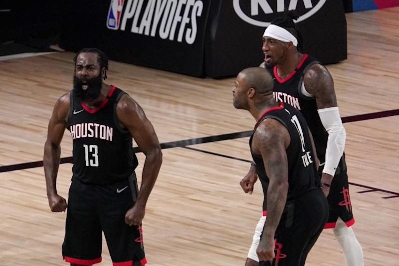 Houston Rockets' James Harden (13), P.J. Tucker, front, and Robert Covington, right rear, celebrate after Harden blocked a Oklahoma City Thunder's Luguentz Dort (5) 3-point shot attempt during the second half of an NBA first-round playoff basketball game in Lake Buena Vista, Fla., Wednesday, Sept. 2, 2020. (AP Photo/Mark J. Terrill)