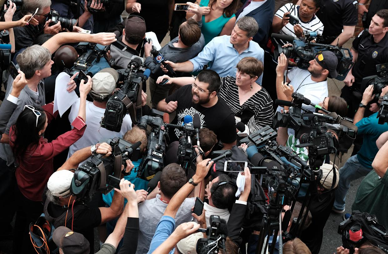"""White nationalist leader Matthew Heimbach (C) screams at the media in defense of James Alex Fields Jr. outside of Fields bail hearing on charges of suspicion of murder, malicious wounding and hit-and-run charges ensuing from Fields arrest after a car hit counter protesters at the """"Unite the Right"""" rally in Charlottesville, Virginia, August 14, 2017. (Photo: Justin Ide/Reuters)"""