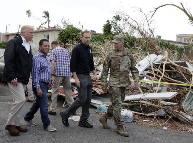 <p>President Donald Trump takes a walking tour to survey hurricane damage and recovery efforts in a neighborhood in Guaynabo, Puerto Rico, Tuesday, Oct. 3, 2017. (Photo: Evan Vucci/AP) </p>