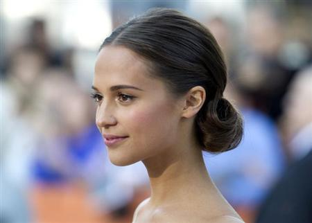 "Cast member Alicia Vikander arrives for the premiere of the film ""The Fifth Estate"" at the 38th Toronto International Film Festival in Toronto September 5, 2013. REUTERS/Fred Thornhill"