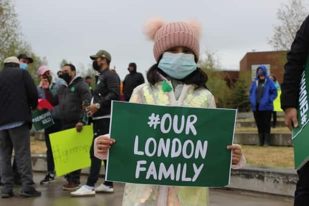Residents, both young and old, held signs that honoured the victims of Sunday's attack in London, Ont., and decried Islamophobia and the existence of hate in Canada. (Liny Lamberink/CBC - image credit)