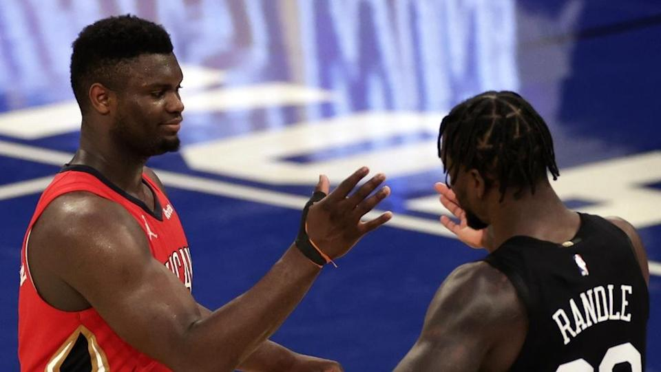 New Orleans Pelicans forward Zion Williamson shakes hands with New York Knicks forward Julius Randle (30) after overtime at Madison Square Garden. The Knicks won in overtime 122-112.