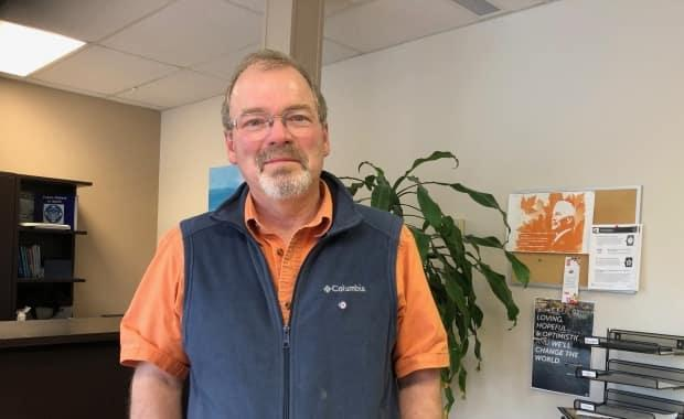 Ted Hupe is president of the Yukon Teachers Association. He says staff shortages behind the scenes at the territory's education department are causing teacher shortages in the classroom. (Laura Howells/CBC - image credit)