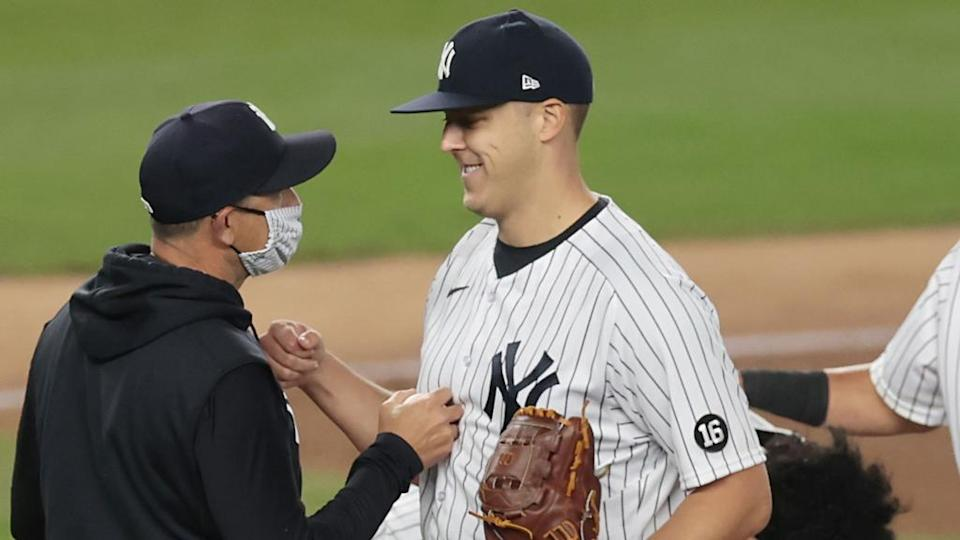 Jameson Taillon smiles handing ball to Aaron Boone after Yankees debut