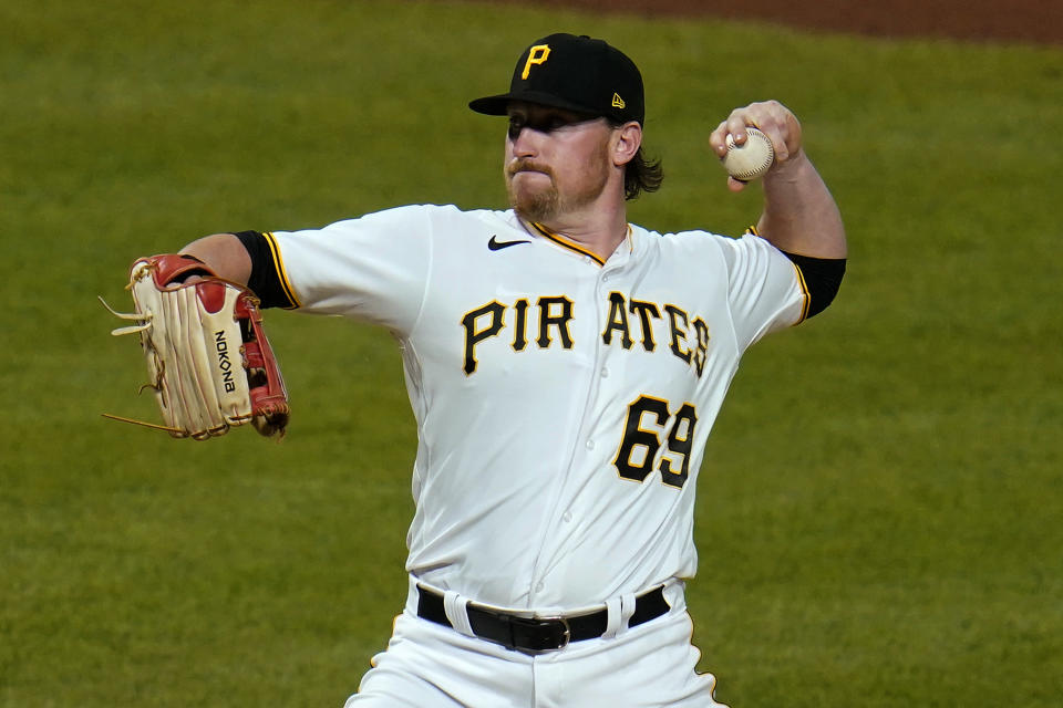 Pittsburgh Pirates first baseman John Nogowski pitches in relief during the ninth inning of the team's baseball game against the Milwaukee Brewers in Pittsburgh, Thursday, July 29, 2021. The Brewers won 12-0. (AP Photo/Gene J. Puskar)