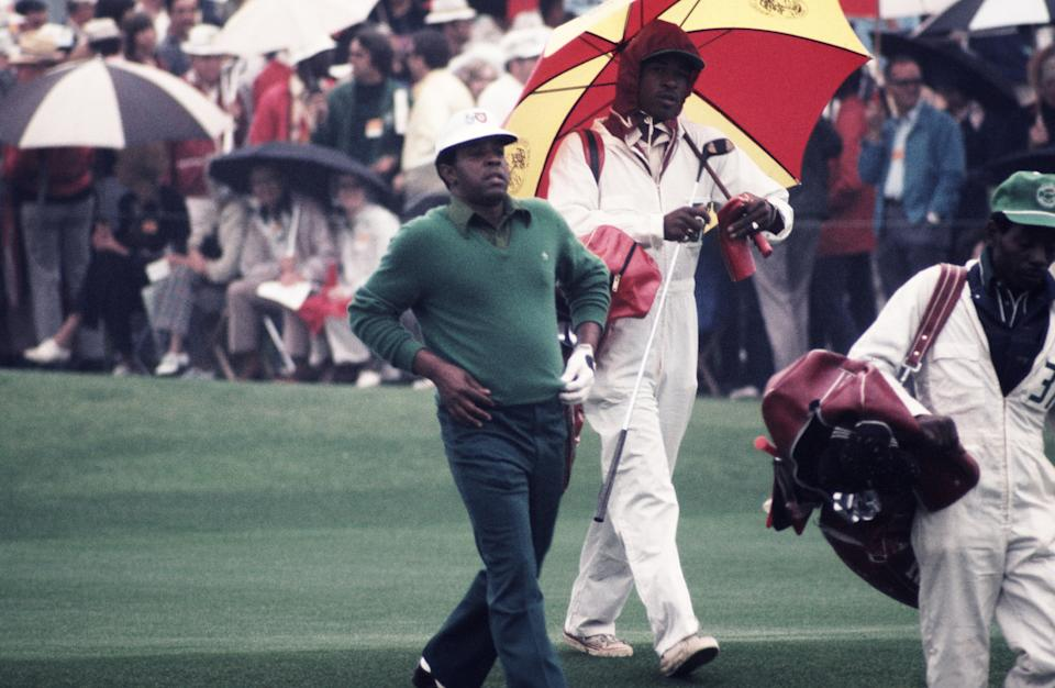 Lee Elder walks down the fairway at Augusta in 1975. (Photo by Augusta National/Getty Images)
