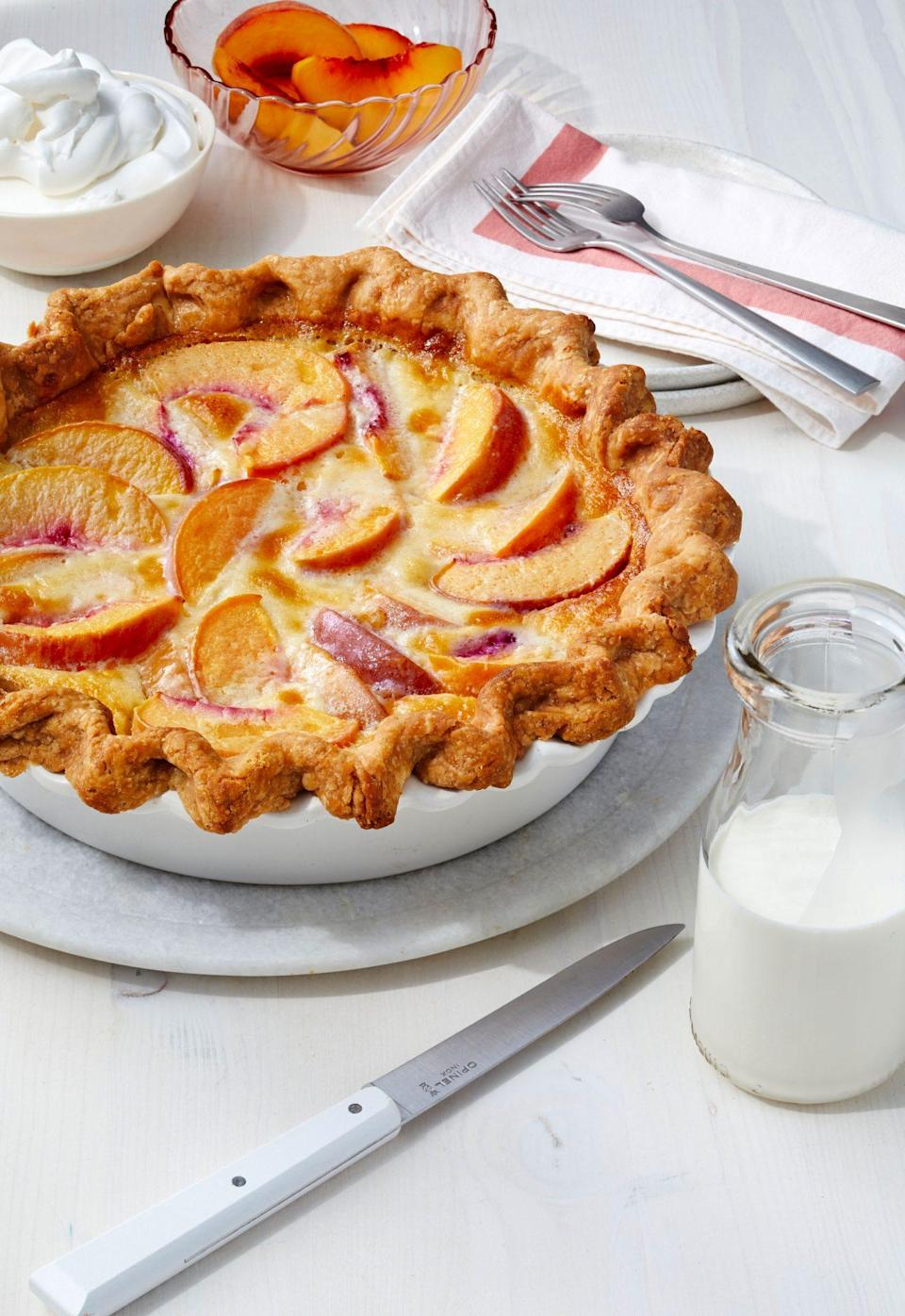"<p><strong>Recipe: </strong><a href=""https://www.southernliving.com/recipes/peach-custard-pie"" rel=""nofollow noopener"" target=""_blank"" data-ylk=""slk:Peach Custard Pie"" class=""link rapid-noclick-resp""><strong>Peach Custard Pie</strong></a></p> <p>This recipe from our July 2020 issue combines the best of creamy old-school pies with fresh summer peaches. It's easy and beautiful, which makes it ideal for simple summer gatherings. One reader said it's ""easy and absolutely delicious.""</p>"