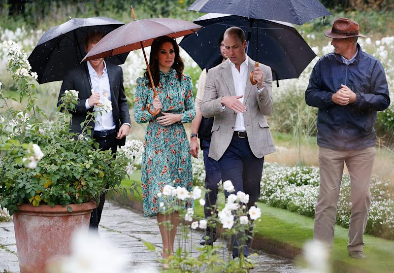 """Kate, do you mind moving your umbrella?"" a photographer shout-whispers, ""You're blocking Harry."" Kate turns around: ""Oh goodness, didn't even realize!"""