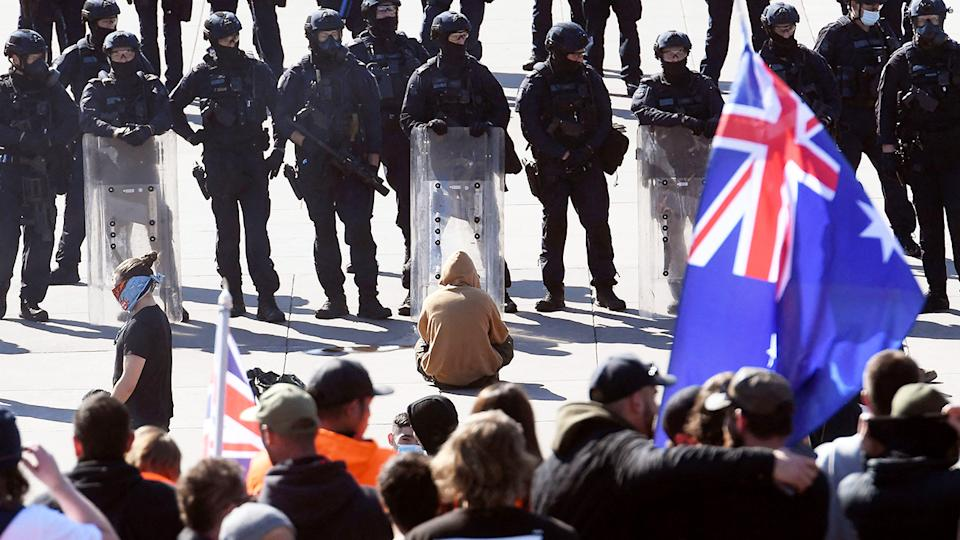 Police, pictured here standing guard as demonstrators protest on the steps of the Shrine of Remembrance.