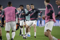 Juventus' Cristiano Ronaldo plays with a ball during warmup before the Champions League, round of 16, second leg, soccer match between Juventus and Porto in Turin, Italy, Tuesday, March 9, 2021. (AP Photo/Luca Bruno)