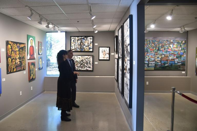 Visitors take in the exhibitions at the Palestinian Museum, a new art museum hoping to change US attitudes toward the Palestinians