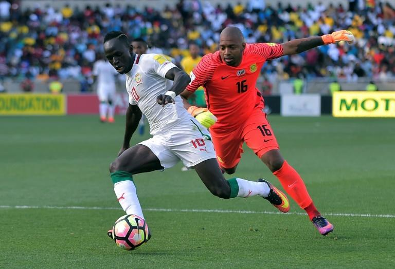 South Africa goalkeeper Itumeleng Khune (R) chases Senegal star Sadio Mane during a 2018 World Cup qualifer.