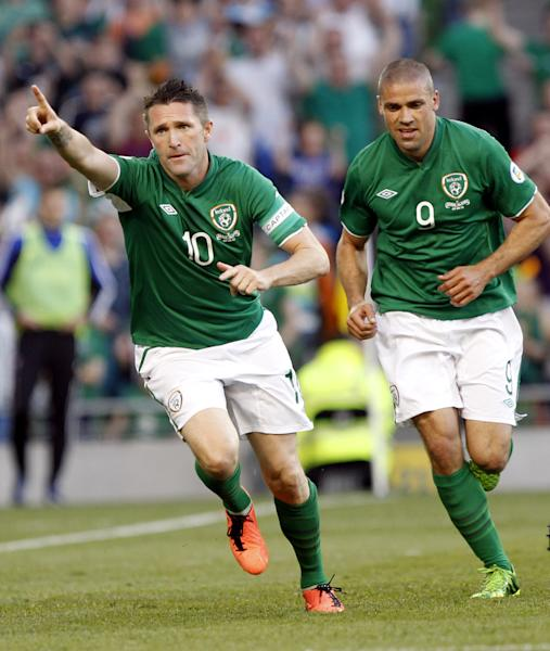 Republic of Ireland's Robbie Keane, left, reacts with Jon Walters after scoring a goal against the Faroe Islands during their World Cup 2014 Qualifying Group C match, at the Aviva stadium, Dublin, Ireland, Friday, June 7, 2013. (AP Photo/Peter Morrison)