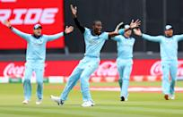 England players celebrate what they thought was the opening wicket. (Photo by Michael Steele/Getty Images)