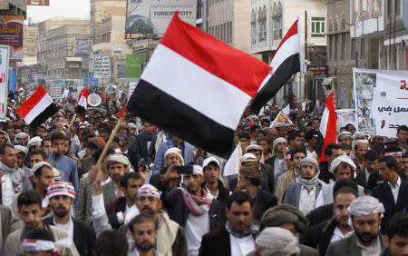 Protesters wave Yemeni national flags as they march during a demonstration organized by the Shi'ite Houthi movement to demand the government to rescind a decision to curb fuel subsidies in Sanaa August 21, 2014. RUETERS/Mohamed al-Sayaghi