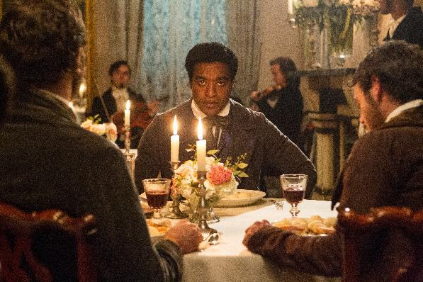 """This film publicity image released by Fox Searchlight shows Chiwetel Ejiofor in a scene from """"12 Years A Slave."""" With the tightest three-way Oscar race in years, the 66th Directors Guild of America Awards could give """"Gravity,"""" """"American Hustle"""" or """"12 Years a Slave"""" the edge in the home stretch to the Oscars. The DGA hands out awards for best director in TV and movie categories in Los Angeles on Saturday, Jan. 25, 2014 in what customarily is a final calling for the film that wins the picture and director Oscars.(AP Photo/Fox Searchlight Films, Jaap Buitendijk)"""
