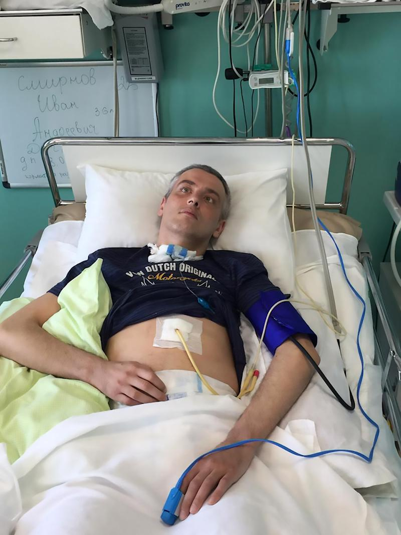 Pic Shows: Ivan Smirnov in Hospital; This father of two is trapped in his own body being fully conscious but barely able to move or talk after doctors repeatedly misdiagnosed his stroke.