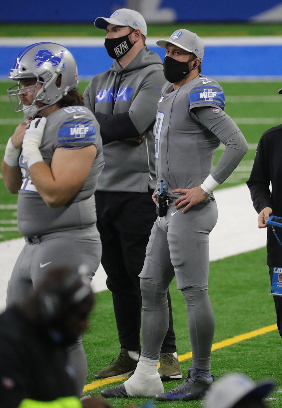 Detroit Lions quarterback Matthew Stafford stands on the sideline with an ankle injury during the first half against the Tampa Bay Buccaneers, Saturday, Dec. 26, 2020 at Ford Field.