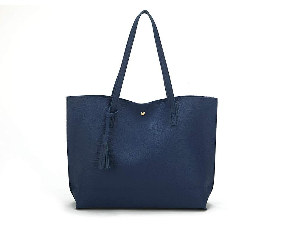 """<h3>Fashion-Meets-Function Tote</h3><br>Made from premium quality PU-leather with a soft-pebbled pattern and tassel-accent, this stylish and roomy top-handle bag comes with a magnetic closure for more secure toting.<br><br><strong>Rating: </strong>4.3 out of 5 stars, and 12,573 reviews<br><br><strong>A Satisfied Customer Review: </strong>""""This purse is really sturdy. It has reinforced stitching on it. I gave it to my wife to keep in her car for when we go grocery shopping in grocery stores that require you to bring your own bags, like Aldi. It also would make a great purse. It's VERY soft. Which, is very nice. It's soft enough to roll up to save space in our vehicles.""""<br><br><strong>Nodykka</strong> Top Handle Tote Bag With Leather Tassel, $, available at <a href=""""https://www.amazon.com/Nodykka-Satchel-Handbags-Pebbled-Shoulder/dp/B07DGGWXMZ/ref=sr_1_1"""" rel=""""nofollow noopener"""" target=""""_blank"""" data-ylk=""""slk:Amazon"""" class=""""link rapid-noclick-resp"""">Amazon</a>"""