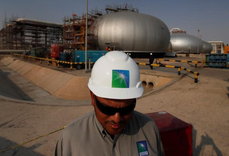 FILE PHOTO: An employee in a branded helmet is pictured at Saudi Aramco oil facility in Abqaiq