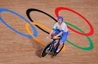 <p>Italy's Simone Consonni is in shock after winning gold and setting a new world record in the men's track cycling team pursuit finals at Izu Velodrome on August 4.</p>