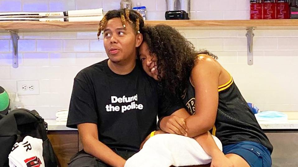 Naomi Osaka (pictured right) hugging her boyfriend Cordae at the US Open.