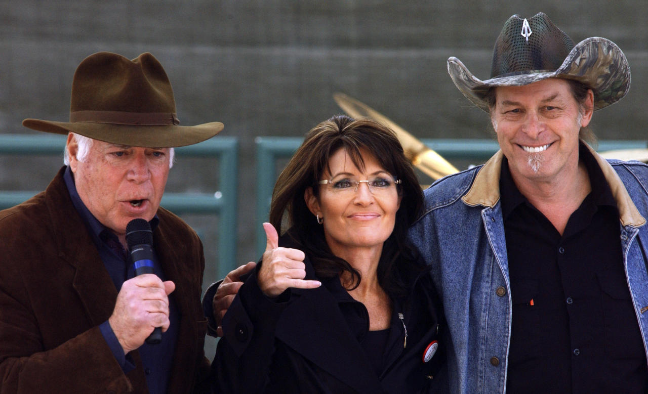 Republican candidate for Senate, John Raese, left, Sarah Palin, center, and performer Ted Nugent embrace during a rally in Charleston, W.Va., on Saturday, Oct. 30, 2010.