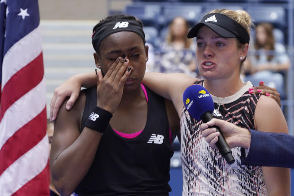 Coco Gauff, left, and Catherine McNally, both of the United States, become emotional as they speak to the crowd after losing to Shual Zhang, of China, and Samatha Stosur, of Australia, in the women's doubles final at the US Open tennis championships, Sunday, Sept. 12, 2021, in New York. (AP Photo/Elise Amendola)
