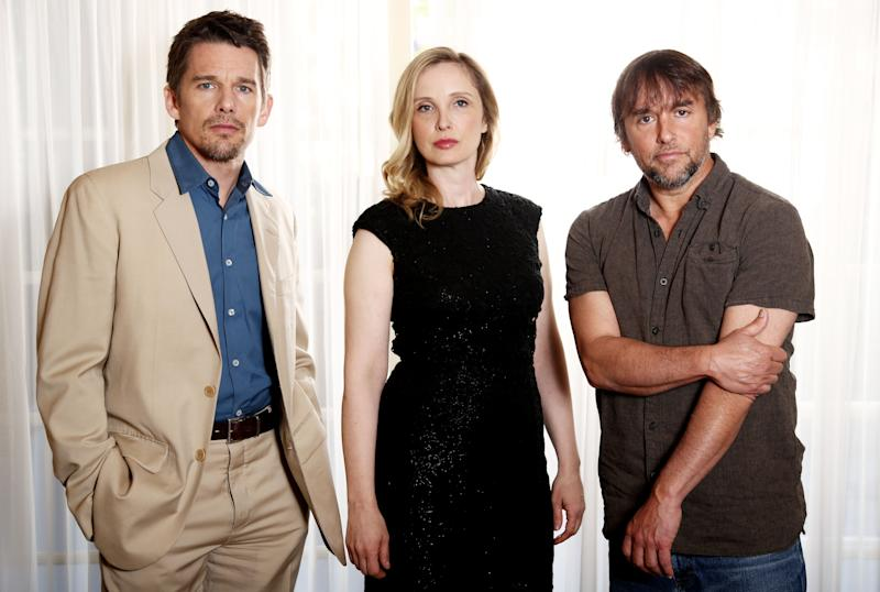 """In this Monday, May 20, 2013 photo, from left, actor and writer, Ethan Hawke, actress and writer, Julie Delpy and director and writer, Richard Linklater, from the film """"Before Midnight,"""" pose for a portrait in Los Angeles. This is the third drama film in the series of walking, talking European romances. The movie releases in the US on Friday, May 24, 2013. (Photo by Matt Sayles/Invision/AP)"""