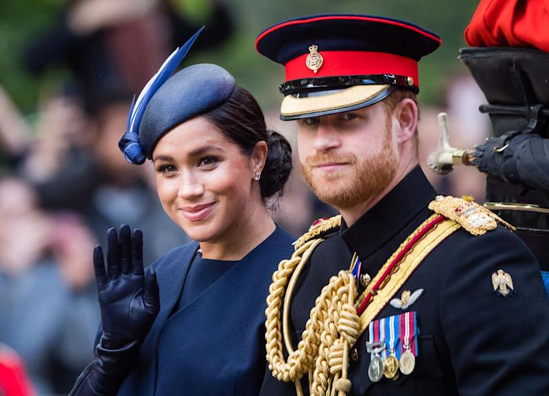 Meghan Markle and Prince Harry ride on a carriage