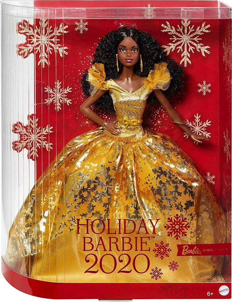 """Barbie releases a collectible """"<a href=""""https://barbie.mattel.com/shop/en-us/ba/barbie-holiday-dolls#facet:&amp;productBeginIndex:0&amp;orderBy:&amp;pageView:grid&amp;minPrice:&amp;maxPrice:&amp;pageSize:&amp;contentPageSize:&amp;"""" target=""""_blank"""" rel=""""noopener noreferrer"""">Holiday Doll</a>"""" every year. This year, the doll glitters in a gold gown, gold makeup and gold earrings. There's a blonde and brunette version of this Barbie, too.<a href=""""https://amzn.to/35WSrnw"""" target=""""_blank"""" rel=""""noopener noreferrer"""">Find it for $39 at Amazon</a>."""