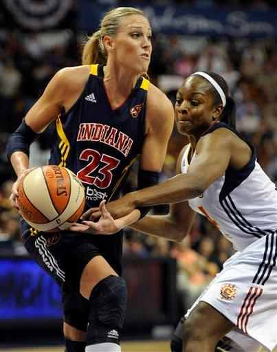 Indiana Fever's Katie Douglas, left, is pressured by Connecticut Sun's Danielle McCray during the first half of Game 1 of the WNBA basketball Eastern Conference Finals in Uncasville, Conn., Friday, Oct. 5, 2012. (AP Photo/Jessica Hill)