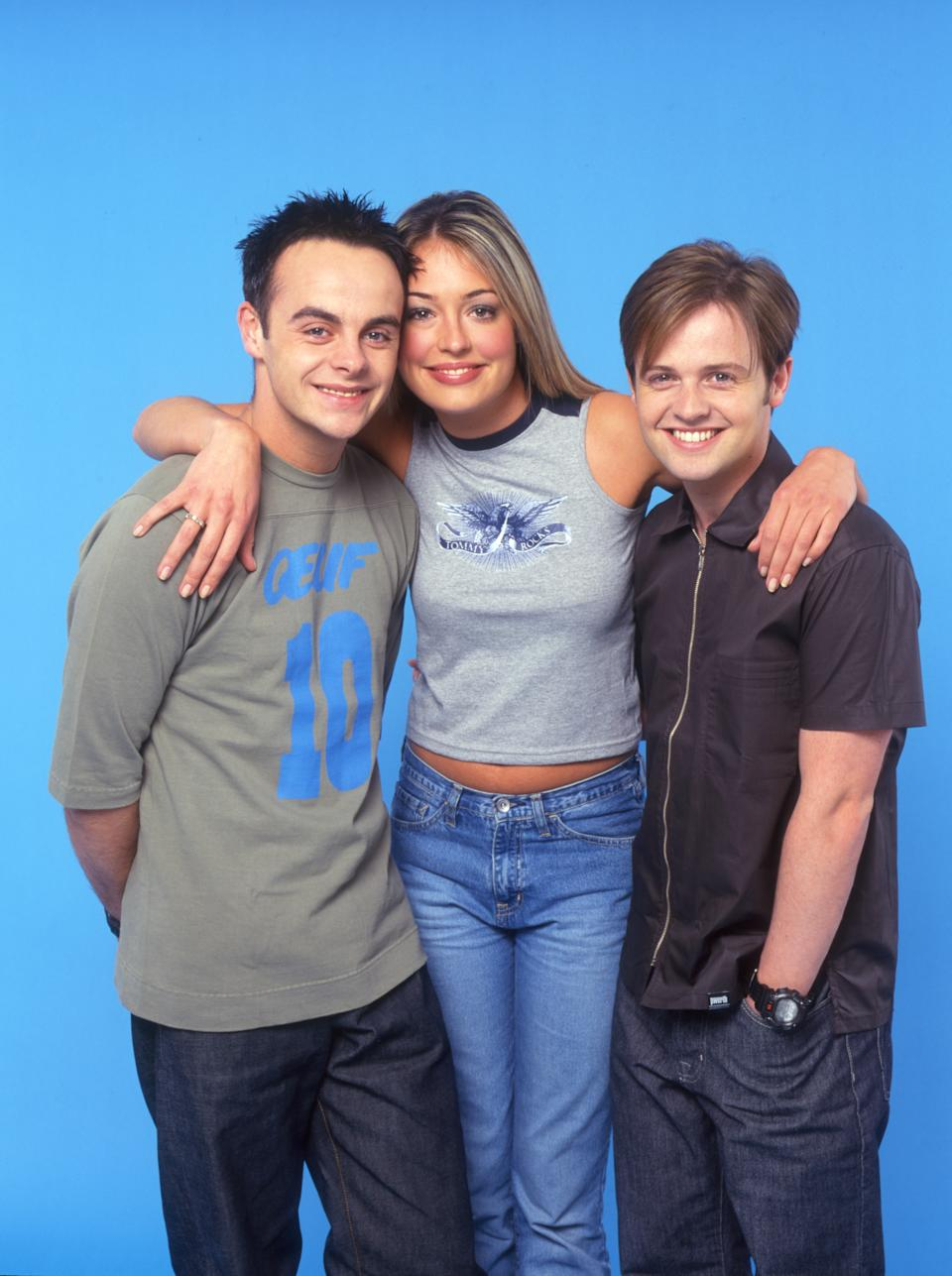 Television presenters Anthony McPartlin, Cat Deeley and Declan Donnelly, co-hosts of Saturday morning television series, 'SMT Live', circa 1998. (Photo by Tim Roney/Getty Images)