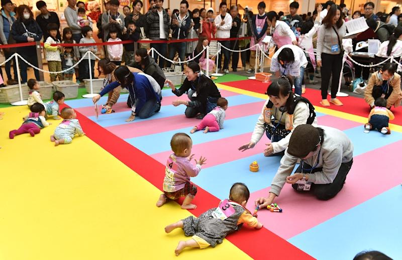 Small children are a particularly vulnerable population who are exposed to THS toxicants through inhalation, ingestion and dermal contact (AFP Photo/Kazuhiro Nogi)