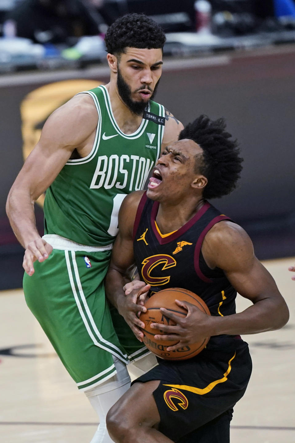 Cleveland Cavaliers' Collin Sexton, right, drives against Boston Celtics' Jayson Tatum during the second half of an NBA basketball game Wednesday, May 12, 2021, in Cleveland. (AP Photo/Tony Dejak)