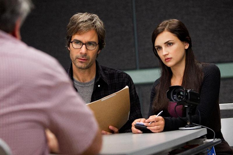"""This publicity image released by TNT shows Eric McCormack, left, and Rachael Leigh Cook in a scene from """"Perception,"""" premiering Monday at 10 p.m. EDT on TNT. McCormack portrays Dr. Daniel Pierce, a brilliant neuroscience professor with paranoid schizophrenia who is recruited by the FBI for a side job: to help solve cases that call for expertise in human behavior and the workings of the mind. (AP Photo/TNT, Doug Hyun)"""