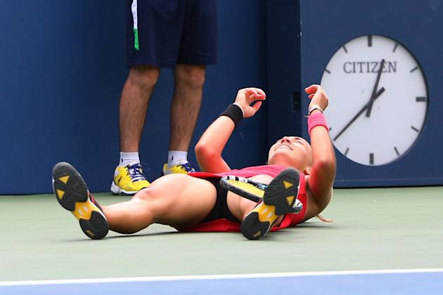Aug 30, 2014; New York, NY, USA; Aleksandra Krunic (SRB) falls to the ground after defeating Petra Kvitova (CZE) at Armstrong Stadium on day six of the 2014 U.S. Open tennis tournament at USTA Billie Jean King National Tennis Center. (Anthony Gruppuso-USA TODAY Sports)