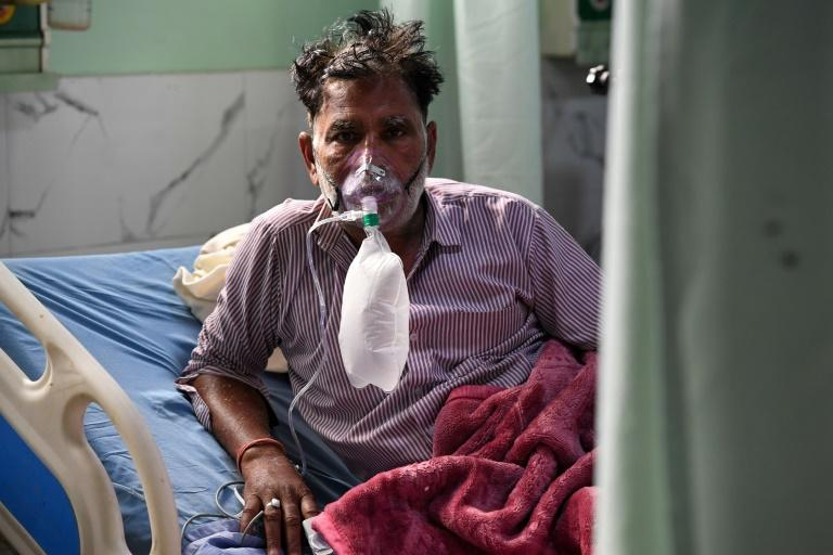 A Covid-19 coronavirus patient breaths with the help of an oxygen mask inside the Intensive Care Unit (ICU) of the Teerthanker Mahaveer University (TMU) hospital in Moradabad