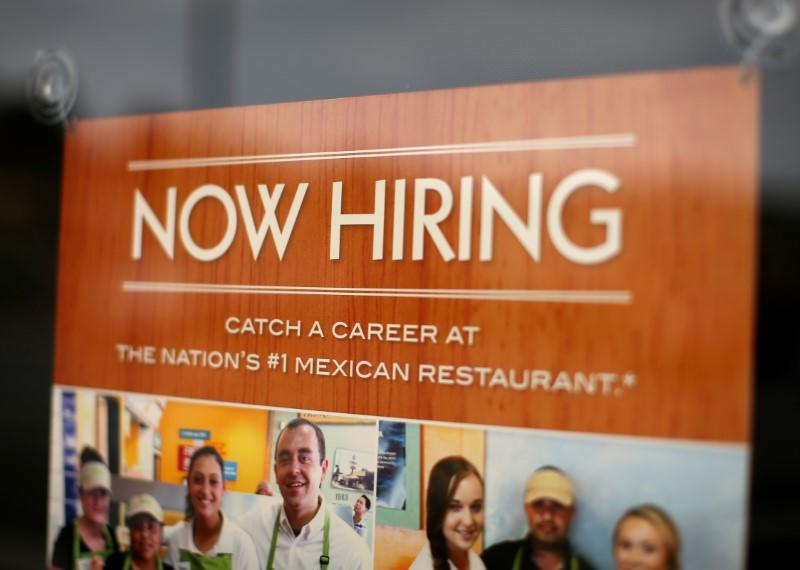 A fast food restaurant advertises for workers on its front window in Encinitas, California