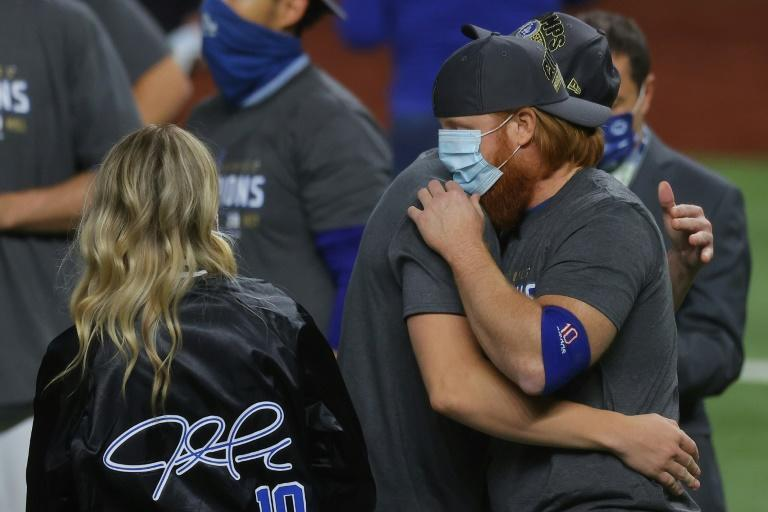 Justin Turner celebrates a World Series victory with Los Angeles Dodgers teammates despite being pulled from game six in the eighth inning after testing positive for coronavirus