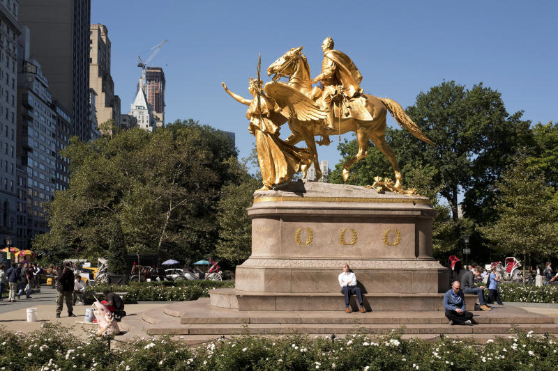FILE - In this Oct. 6, 2016 file photo, a statue of Civil War Gen. William Tecumseh Sherman is located at an entrance to New York's Central Park. The park currently has 23 statues of men who left their mark on history. New York City has approved a Central Park monument featuring - for the first time - accomplished women. A city commission voted Monday, Oct. 21, 2019, to erect the tribute to three civil rights pioneers. Artist Meredith Bergmann's sculpture honoring Susan B. Anthony, Elizabeth Cady Stanton and Sojourner Truth is to be dedicated next August, marking the 100th anniversary of women's suffrage in the United States. (AP Photo/Mark Lennihan, File)